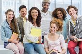 stock photo of classmates  - Fashion students smiling at camera together at the college - JPG