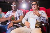 foto of cinema auditorium  - Young friends watching a 3d film at the cinema - JPG