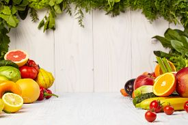 image of fruits  - Fruit and vegetable borders Fruit and vegetable borders on wood table - JPG