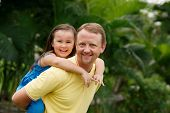 pic of piggyback ride  - Happy father giving piggyback ride to his daughter - JPG