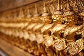 Golden garuda pattern in grand palace, Thailand