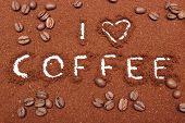 image of coffee grounds  - Coffee word written on ground coffee and coffee grains - JPG