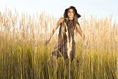 picture of tallgrass  - Sunrise shot of young model in tallgrass meadow - JPG