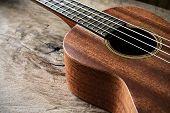picture of ukulele  - Close up of ukulele on old wood background Dark tone - JPG