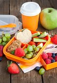 foto of school lunch  - Lunch box for kids with sandwich cookies fresh veggies and fruits - JPG