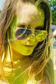 picture of holi  - girl with multicolored face at Holi Festival - JPG