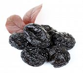 picture of prunes  - Pile of prunes with leaves isolated on white - JPG
