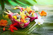 pic of dragon fruit  - Exotic fruit salad served in half a dragon fruit - JPG