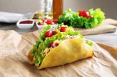 pic of tacos  - Tasty taco with vegetables on paper on table close up - JPG