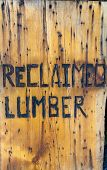 "image of lumber  - ""reclaimed lumber"" burned into board promoting reuse and recycling of old lumber - JPG"