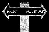 image of policy  - Opposite arrows with Policy versus Procedure. Hand drawing with chalk on blackboard. Choice conceptual image - JPG