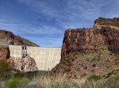 stock photo of dam  - The Theodore Roosevelt Dam is a dam on the Salt River and Tonto Creek located northeast of Phoenix Arizona USA - JPG