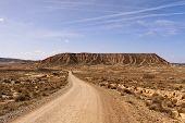 stock photo of arid  - road throught arid landscape Bardenas Reales Navarra Spain - JPG