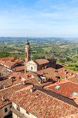 pic of red roof  - Church and red roofs in town of La Morra as green hills on background in Piedmont - JPG