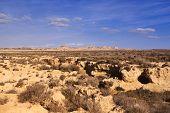 picture of arid  - Arid landscape at daytime in Bardenas Reales Navarra Spain - JPG