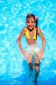 foto of mattress  - Little girl swimming on  mattress in blue water - JPG