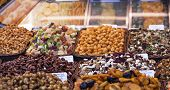 image of dry fruit  - Nuts and almonds and dried fruits for sale at the market - JPG