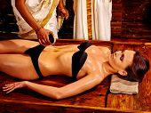 picture of panchakarma  - Young woman having stomach pouring oil Ayurveda spa treatment - JPG