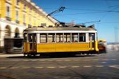 stock photo of tram  - Lisbon traditional old electric tram speeding in Comecio Square - JPG
