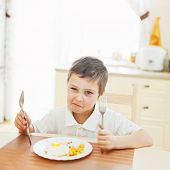 image of disobedient  - Portrait of little boy in the kitchen - JPG