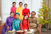 picture of national costume  - Portrait of happy big Vietnamese family in national costumes - JPG