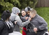 stock photo of gang  - Gang Of Youths Fighting - JPG