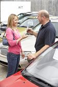 Woman collecting new car