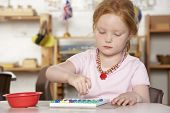 stock photo of nursery school child  - Young Girl Playing at Montessori - JPG