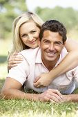 stock photo of middle-age  - Young couple having fun in countryside - JPG