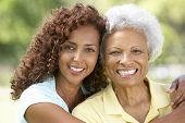 stock photo of african american woman  - Senior Woman With Adult Daughter In Park - JPG