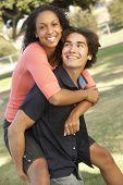 Teenage Couple Having Fun In Playground