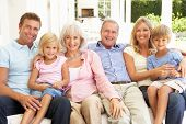 picture of extended family  - Extended Family Relaxing Together On Sofa - JPG