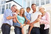 stock photo of extended family  - Extended Family Outside Modern House - JPG
