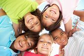 pic of children group  - Group Of Children Looking Down Into Camera - JPG