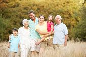 stock photo of extended family  - Portrait Of Extended Family Group In Park - JPG