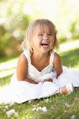 stock photo of young girls  - Young girl posing in park - JPG