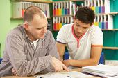 pic of tutor  - Teenage Student In Classroom With Tutor - JPG
