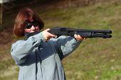 Woman Takes Aim With A Shotgun