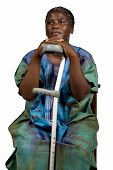 stock photo of crotch  - invalid old African woman with a crotch white hair in traditional dress natural no makeup - JPG