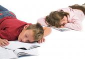 Young boy and girl fell asleep after hard learning