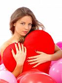beautiful woman with red heart in balloons isolated on white
