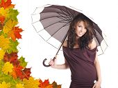 Sexy girl  with brown umbrella. Leaves background