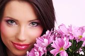 Attractive young woman face with flowers