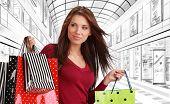 Beautiful shopping woman at a drawn mall
