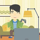 Постер, плакат: An asian happy gamer playing video game on the television An excited young man with console in hand