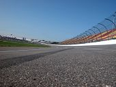 picture of race track  - asphalt paved super speedway motor sports race track - JPG