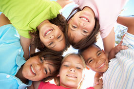 foto of children group  - Group Of Children Looking Down Into Camera - JPG