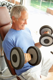 picture of lifting weight  - Senior Man Working With Weights In Gym - JPG