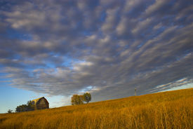stock photo of western nebraska  - Farm building with spectacular sky during last moments of the sunset with sign saying  - JPG
