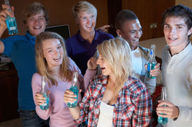 foto of underage  - Group Of Teenage Friends Dancing And Drinking Alcohol - JPG